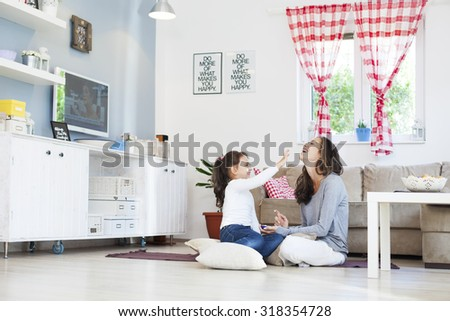 Mom and daughter in the living room