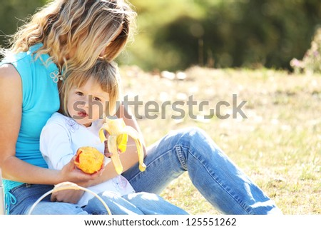 Mom and daughter on picnic on nature