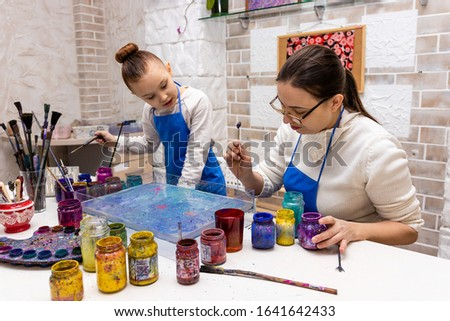 """Mom and daughter together doing Ebru Art, the Ancient Techniques of """"Painting on Water"""""""
