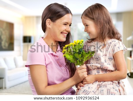 Mom and daughter with flowers #1092936524