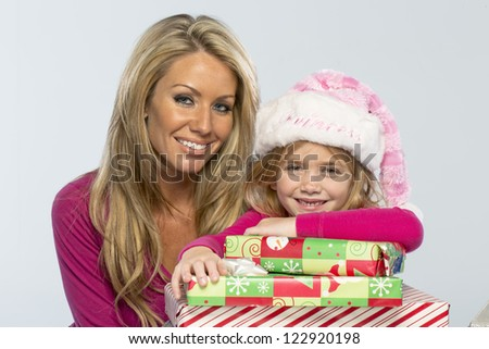 Mom and daughter with missing teeth shows excitement with presents