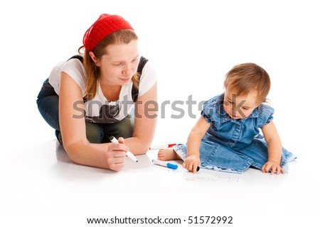 Mom and her baby  writing with white board markers - stock photo