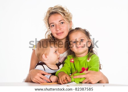 mom and her children drawing at table