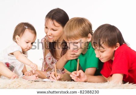 mom and her children drawing on carpet