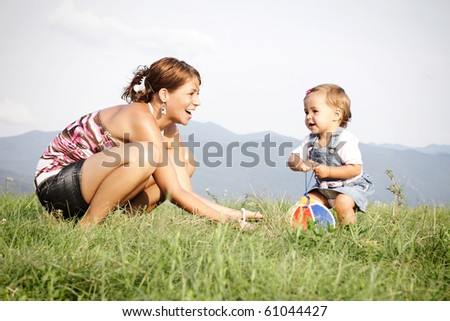 Mom and her little daughter having fun
