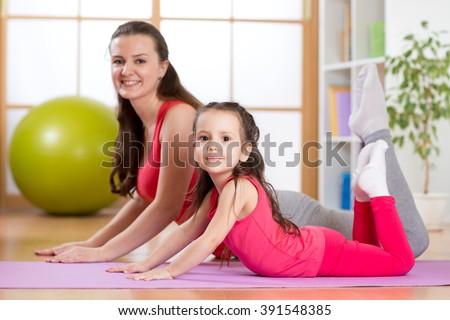 Mom and kid do gymnastics. Family sports