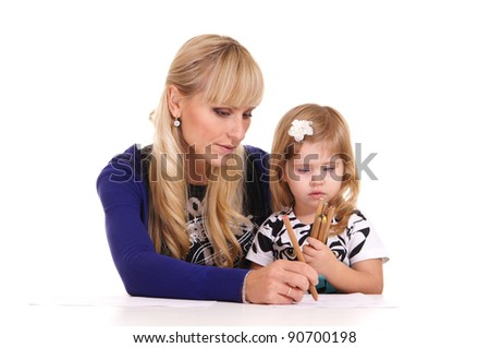 mom and little daughter drawing at table
