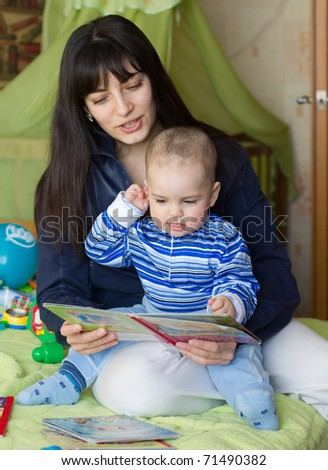 Mom and the little boy reading a book
