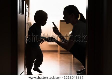 Mom disciplining her child. Teaching-parenting your kid concept.  ストックフォト ©