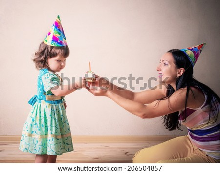 Mom gives daughter a birthday cake