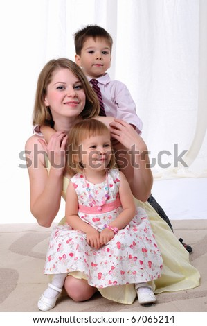 Mom, her son and her little daughter together having fun