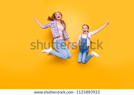 Mom mum mommy maternity two people best friendship upbringing rejoicing concept. Full length size portrait of cheerful joyful stylish modern relatives jumping up in air isolated on bright background #1125883922