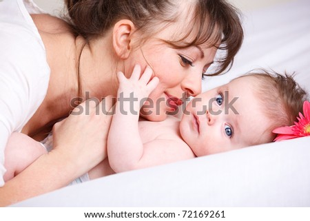 Mom playing with cute baby
