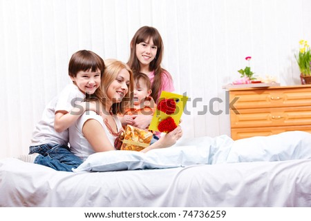 Mom reading greeting card made by kids