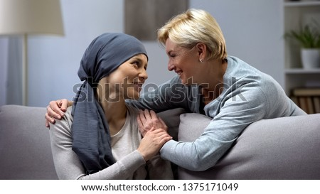 Mom supporting and hugging her daughter with cancer, visits in oncohospital #1375171049