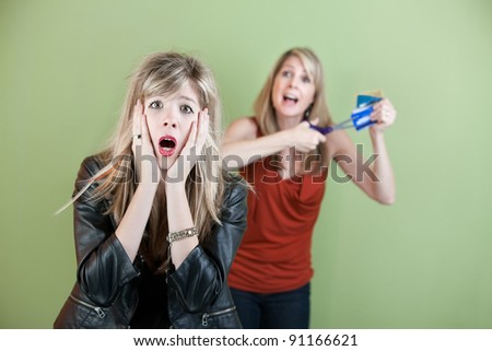 Mom threatens to cut daughter's credit cards with a scissors