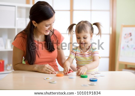 Mom with creative child daughter having fun time together.
