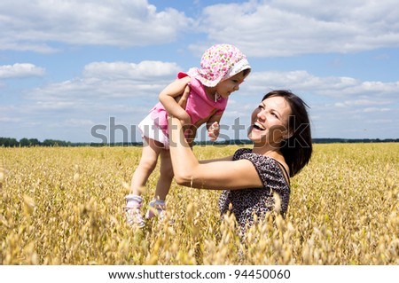 mom with her daughter in the field