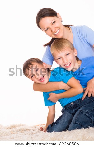 mom with her two children on a light background - stock photo
