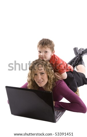 Mom working on a computer with her son on her back