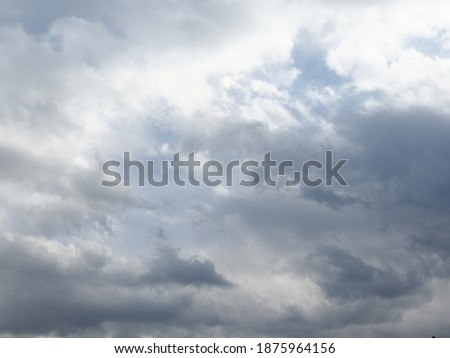 Moment of fluffy cloudy floating on dusk soft blue sky in evening. Gloomy sky. Overcast sky atmosphere.   Сток-фото ©