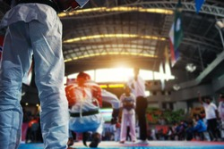 Moment of Taekwondo player in the stadiums with Coach standing. Athlete to strike an opponent during the tournament taekwondo.