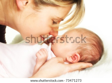 Moment of tenderness between a mother and her 18 days old baby