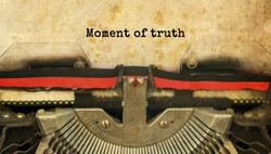 Moment of truth typed words on a vintage typewriter with vintage background