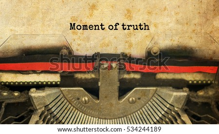 Moment of truth typed words on a vintage typewriter with vintage background                                #534244189