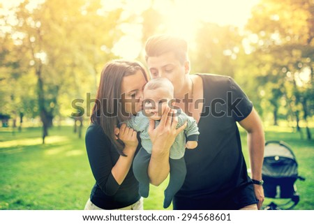 mommy and daddy holding baby  3 ...