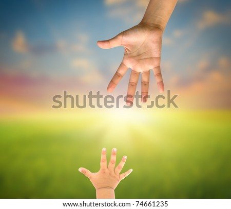 Mommy and her child hand - stock photo