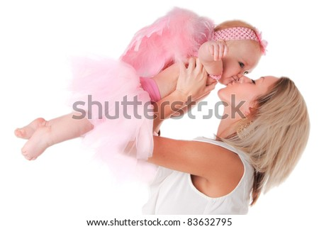 Mommy holding and kissing her baby girl dressed as an Angel
