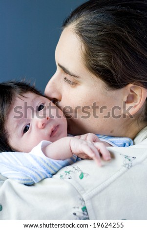 mommy kissing baby - stock photo