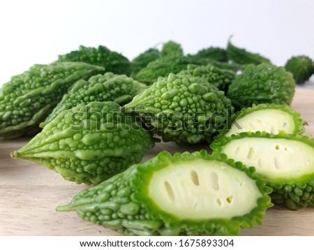 Momordica charantia, Balsam apple, Balsam pear, Bitter cucumber, Bitter gourd, Bitter melon, Carilla fruit   isolated  on  white  background