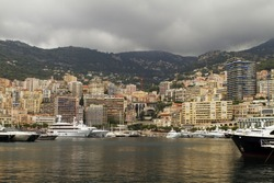 Monaco harbor with several high priced yachts on view. All ID info has been removed from signs and boats.