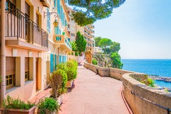 Monaco, Monte carlo. Monaco village with colorful architecture and street along the ocean.