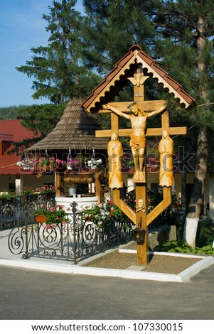 monastery, a well and a crucifix - stock photo