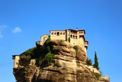 Monastery buildings in Meteora, Greece. These are incredible building constructed precariously on the rock in the mountains.