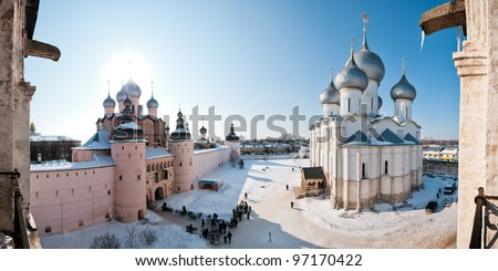 Monastery in snow, two churches with domes on area, panorama