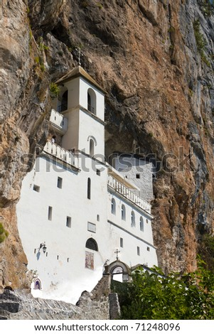 Monastery of Ostrog built into a rock face vertical view, Montenegro