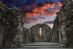 Monastic cemetery of Glendalough, Ireland. Famous ancient monastery while sunset in the wicklow mountains with a beautiful graveyard from the 11th century