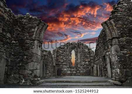 Monastic cemetery of Glendalough, Ireland. Famous ancient monastery while sunset in the wicklow mountains with a beautiful graveyard from the 11th century  Photo stock ©
