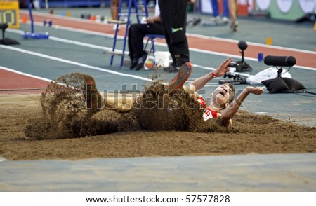 MONCTON, CANADA - JULY 20: Vladimir Golovin of Russia performs the long jump during the 2010 IAAF World Junior Championships on July 20, 2010 in Moncton, Canada.