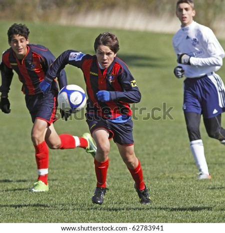 MONCTON, CANADA - OCTOBER 10: A player leads a charge at the 2010 BMO National Championships Boys Soccer U-14 Cup on October 10, 2010 in Moncton, Canada.