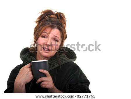 Monday blues - a middle aged woman drinks her morning coffee and is depressed about the work week.
