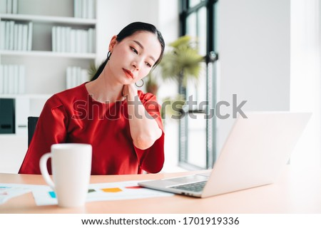 Monday blues Asian woman having neckaches, stressful of work, depressed or having a fever while working at the office, concept of pressure from work, working lifestyle, stressful work. Stock photo ©