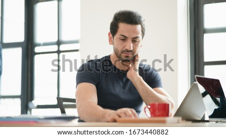 Monday blues of man in the office having headaches, stressful of work, depressed while working at the office, Concept of pressure at work, working lifestyle, stressful work. Over worked. WFH. Stock photo ©