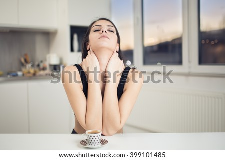 Monday morning.Tired sleepy woman waking up drinking a coffee to wake up early in the morning sunrise.Sore back pain,not enough sleep.Overworked.Insufficient sleep,neck strain.Hangover Stock photo ©