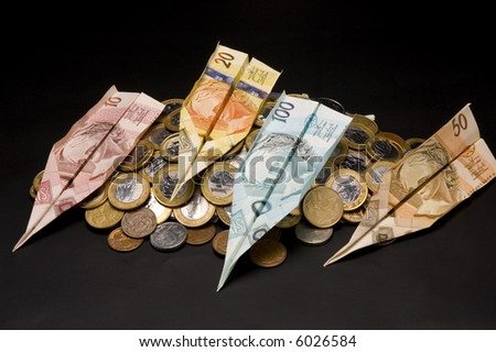 money airplane and coins