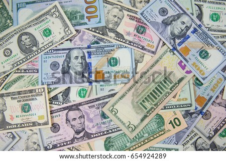 Money american hundred dollar bills Pile of various currencies isolated on white background.Closeup of assorted American banknotes.US currency scattered on the table.america currency dollor currency.